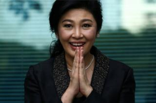 Ousted former Thai prime minister Yingluck Shinawatra greets supporters as she arrives at the Supreme Court in Bangkok, Thailand, August 1, 2017.
