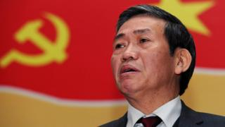 Dinh The Huynh, Central committee member of the ruling Vietnam communist party, answers a question during a press conference in Hanoi on January 10, 2011