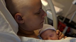 Sarah Hanan and her newborn baby