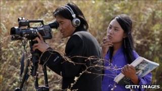 Bhutanese cameraman on location