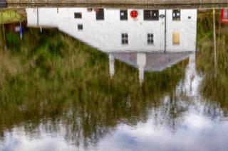 House reflected on water