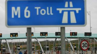 Vehicles approach the M6 motorway toll booths on March 13, 2005 in Birmingham, England.
