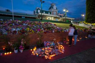 Mourners attend a candlelight vigil outside Dreamworld