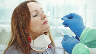 Woman being tested for the virus using a swab test