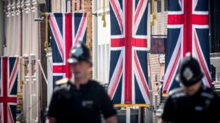 Police officers patrol close to Windsor Castle ahead of the royal wedding