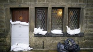 in_pictures Residents defend their homes with the help of soldiers in Mytholmroyd as it prepares for the storm to hit