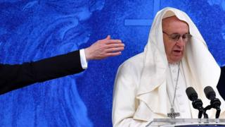 The wind catches the Pope's mozzetta as he recites the Angelus at the Knock shrine