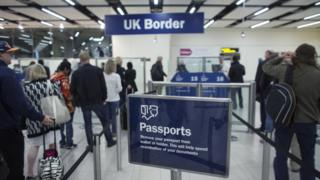 Border Force check passports at Gatwick Airport