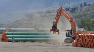 Steel pipe used for the Trans Mountain Expansion Project at a stockpile site in British Columbia