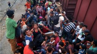 Central American migrants board train wagons in an attempt to make their way to the US border, in the municipality of Arriaga, Chiapas, Mexico, 25 April 2019