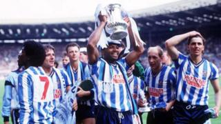 Regis holding the FA cup in 1987 surrounded by his team mates