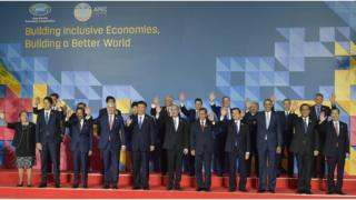 Leaders pose for a group family photo at the Asia-Pacific Economic Cooperation (APEC) summit in Manila, Philippines, 19 November 2015