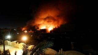 Flames emerge from the Governorate Council building in Basra