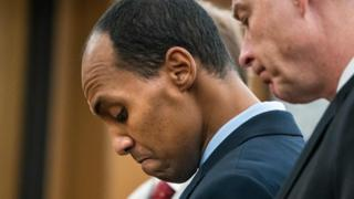 Former Minneapolis police officer Mohamed Noor reads a statement before his sentencing