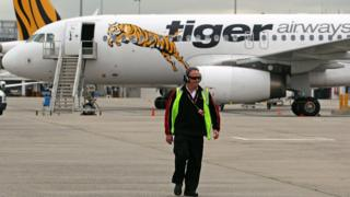 A Tiger Airways flight to Sydney is checked prior to take off