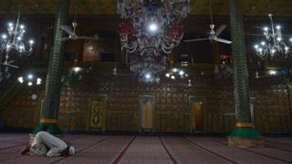 A Muslim prays in Srinagar India