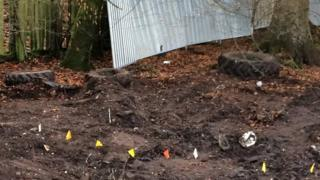 Police markers in Inverkip garden where they are searching