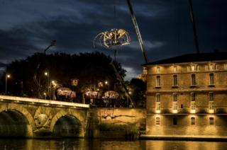 A giant animated spider is moved from the roof of the Hotel-Dieu in Toulouse, southern France, on 1 November 2018.