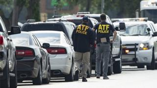 ATF agents arrive on location at Santa Fe High School.