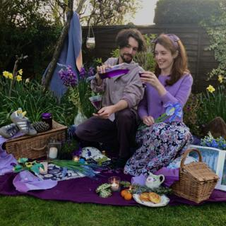Helen Yang and Thomas Etheridge in purple outfits