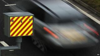 Car speeding past camera