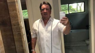 Dad takes pic wearing a white shirt