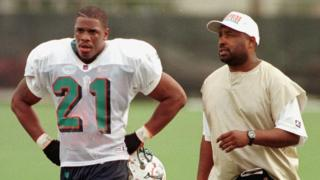 "This file photo taken on December 2, 1997 shows Miami Dolphins"" new running back Lawrence Phillips (L) walking off the practice field"