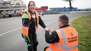 Marshal proposing to his girlfriend at the Isle of Man TT