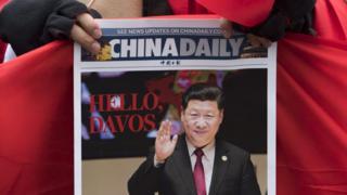 China Daily marks President Xi's Davos visit