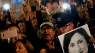 People demonstrate calling for the resignation of Joseph Muscat, following the arrest of one of the country's most prominent businessmen,