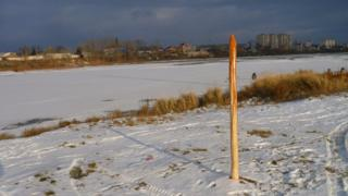 The stake with the river behind