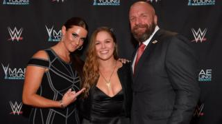 Stephanie McMahon, Ronda Rousey and Triple H