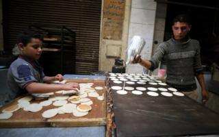 An Egyptian baker prepares Qatayef at a market in Cairo.