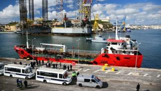 Police forces stand on the pier where Motor Tanker Elhiblu 1 that was hijacked by migrants it had rescued off Libya is docked at Boiler Wharf in Valletta's Grand Harbour on 28 March 2019