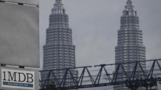 1MDB logo is set against the Petronas Twin Towers