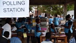 Sierra Leone election workers dey count pipo vote for polling station inside Freetown after di March 7, 2018 election.