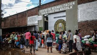 1: Visitors, mainly family members, wait in line to visit prisoners inside Palmasola prison a day after Pope Francis' visit on July 11, 2015 in Santa Cruz, Bolivia