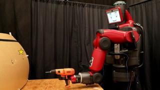 A robot holding a drill