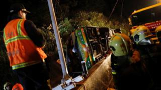Rescuers gather around a crashed bus in Taipei, Taiwan February 13, 2017