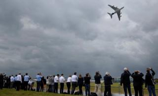 Plane enthusiasts watch an Airbus A380 during a flight demonstration