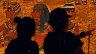 Visitors look at paintings inside the newly restored tomb of King Tutankhamun in the Valley of the Kings, Egypt (31 January 2019)