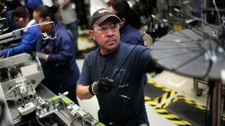 Workers in the auto parts production line of the Bosch factory in San Luis Potosi, Mexico
