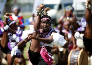 A contest performs in Durban at a Zulu dance competition