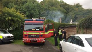 Firefighters and police at scene of the early morning blaze