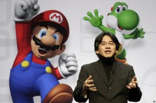 In this 15 July 2008 file photo, Satoru Iwata, President and CEO of Nintendo Co. Ltd., speaks at a news conference where Nintendo unveiled an enhancement for its Wii Remote controller and new games at the E3 Media and Business Summit in Los Angeles. Nintendo said President Iwata died Saturday, July 11, 2015, of a bile duct tumor in a Kyoto hospital, western Japan