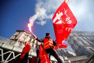 French CGT labour union workers attend a demonstration against government pension reform plans in Marseille on 10 December 2019