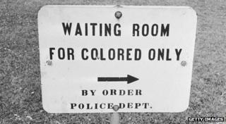 Sign reading waiting room for coloured only.