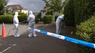 forensic officers at scene