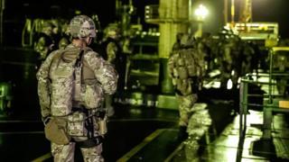 Royal Marines prepare to disembark Grace 1