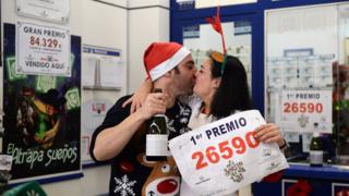 Food Pablo Nogales and his wife Paloma Rodriguez celebrate selling the winning ticket of the biggest prize at a lottery administration in Sevilla on 22 December 2019.
